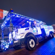 A utility truck is decorated for the Silver Bells in the City parade.